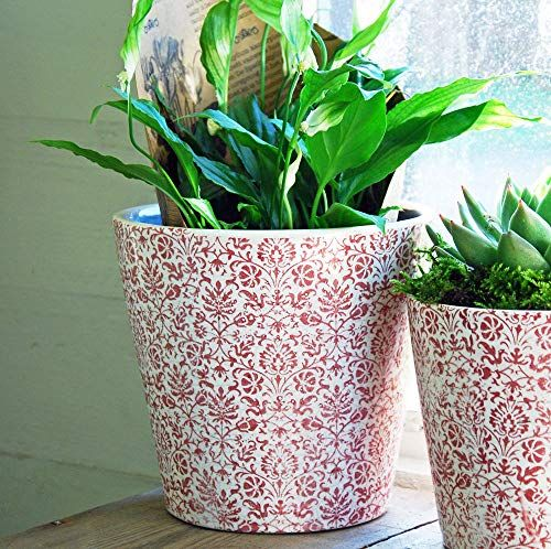 Large red and white terracotta cache pot with crackle glaze