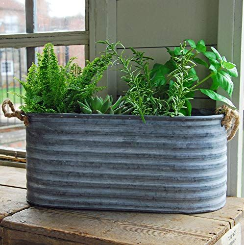 Large grey zinc trough planter with rope handles